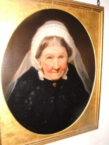 Colour photo of stern looking Victoria lady